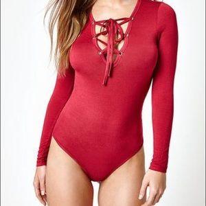 Red full sleeved body suit
